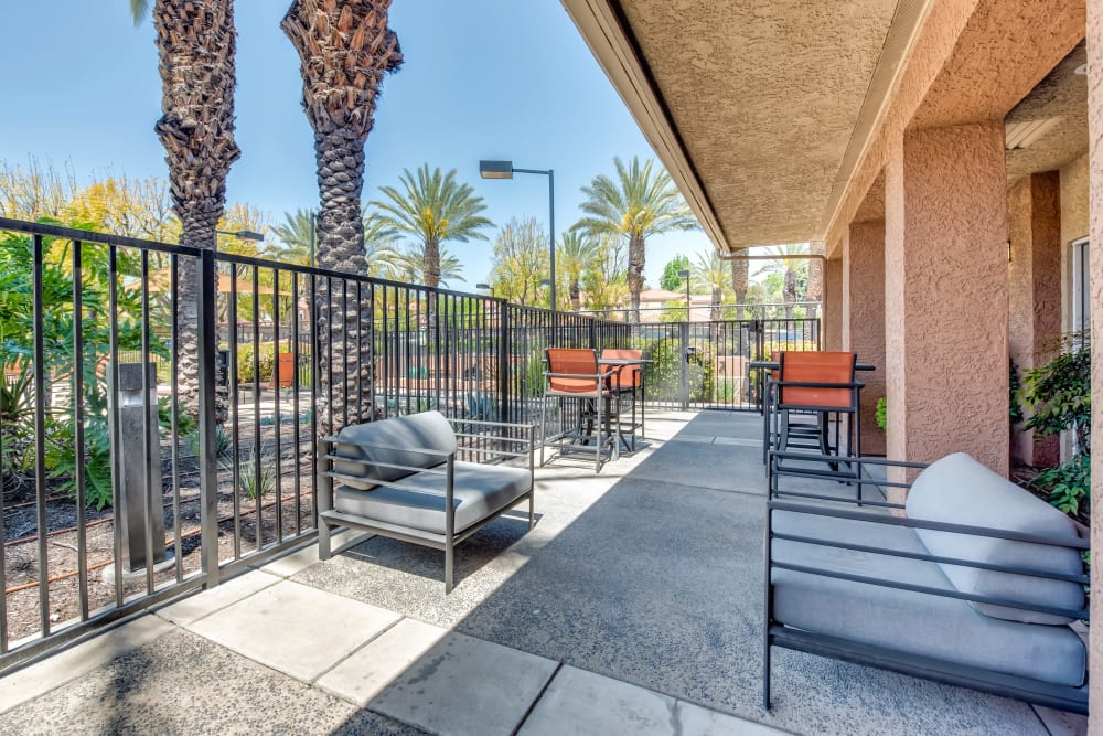 A sunny outdoor patio area at Tuscany Village Apartments in Ontario, California