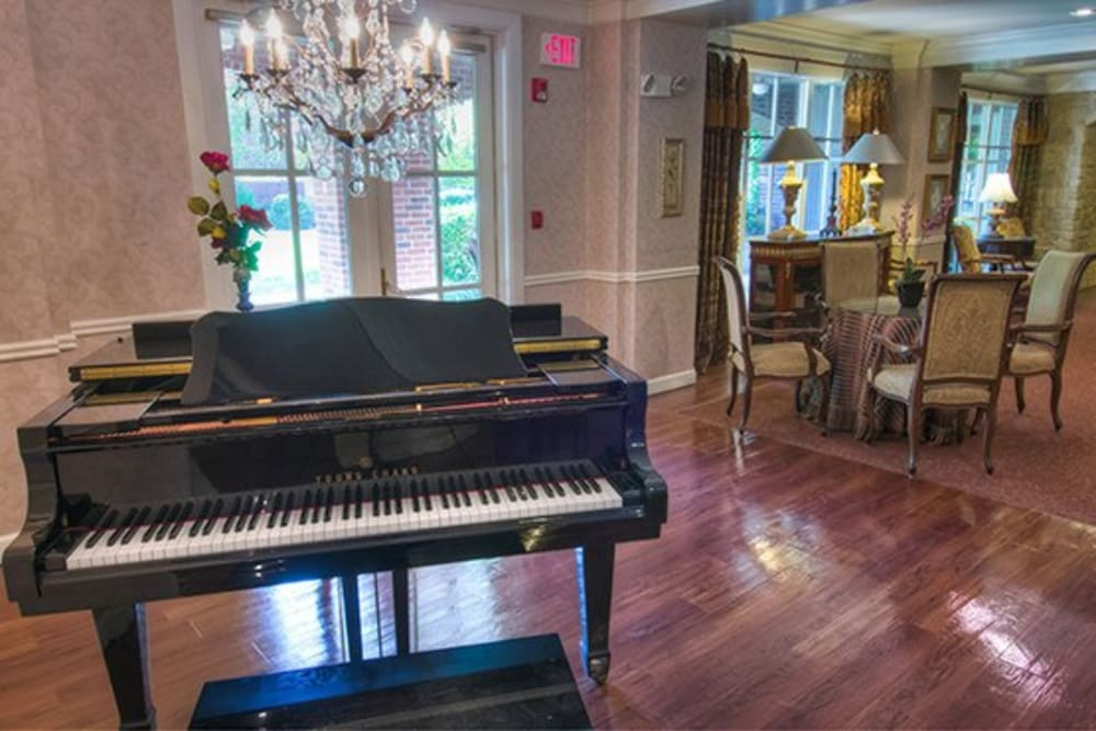 Piano in comfortable lounge area at Mansion at Waterford Assisted Living in Oklahoma City, Oklahoma