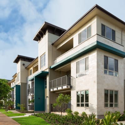 Exterior view of resident building and lush landscaping at Kapolei Lofts in Kapolei, Hawaii