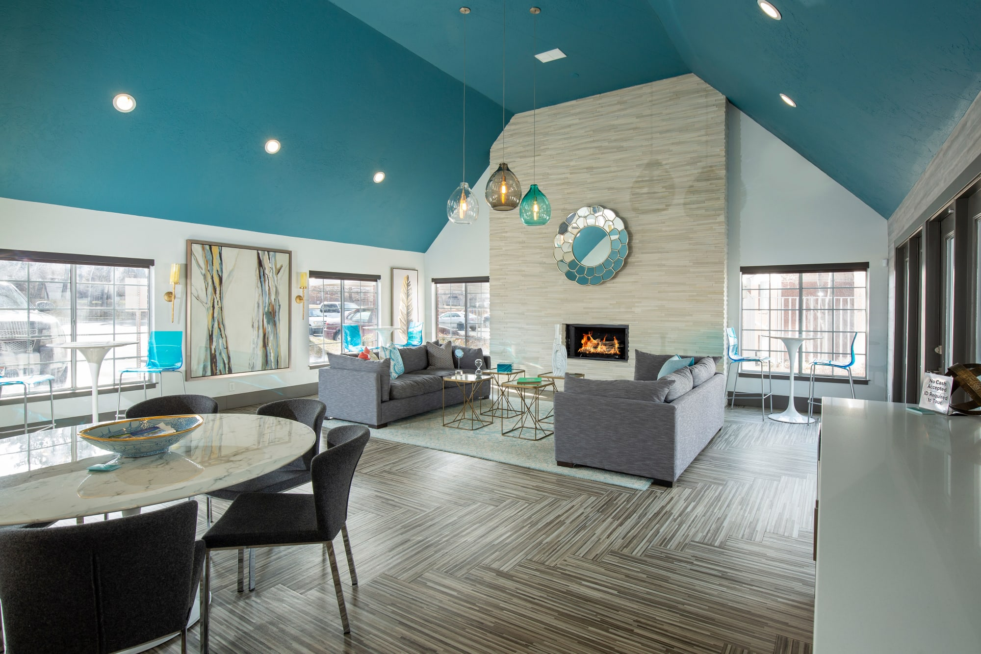 Clubhouse with a lounge area and a fireplace at Windgate Apartments in Bountiful, Utah