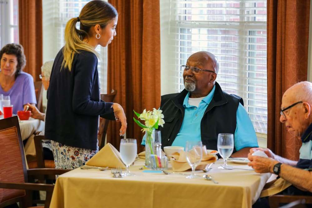 A resident ordering food in the dining room at The Harmony Collection at Columbia - Independent Living in Columbia, South Carolina