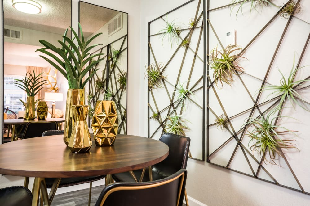 Dining room area with decorative wall art and centerpieces at 4127 Arcadia in Phoenix, Arizona