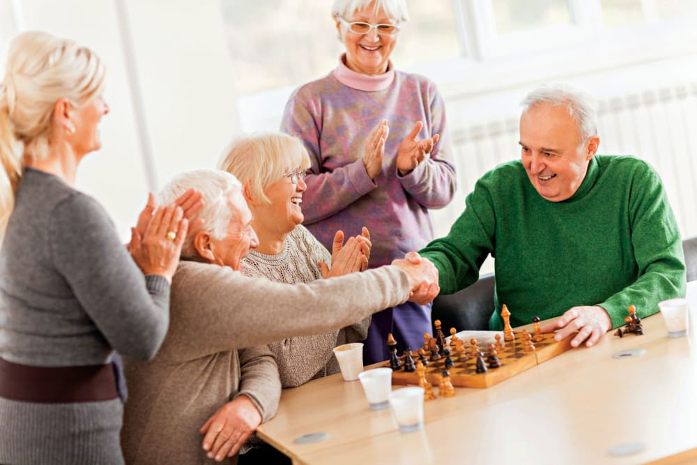 Residents playing chess at Elegance at Novato in Novato, California