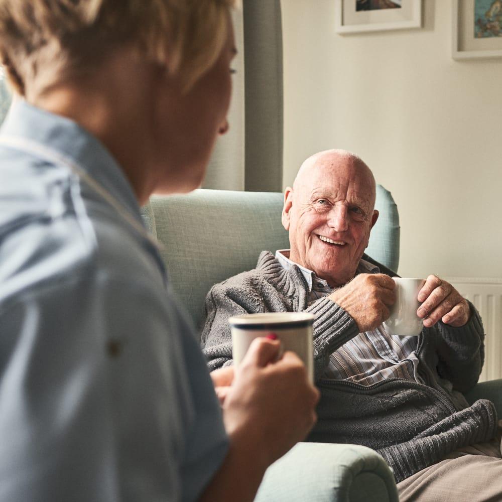 A man and his caregiver at The Palisades at Broadmoor Park