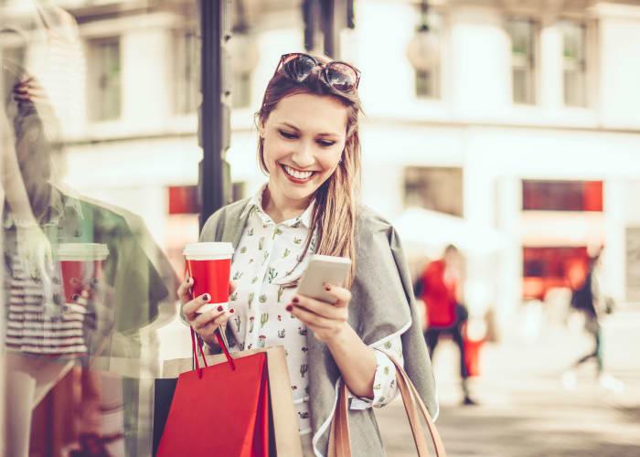 Smiling mom shopping near Greenwoods in Brockton, Massachusetts