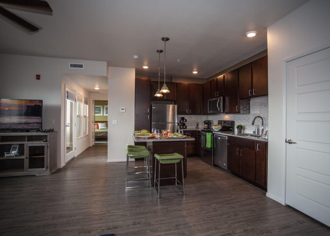 Beautiful, open-concept floor plan with hardwood floors in model home at Kapolei Lofts in Kapolei, Hawaii