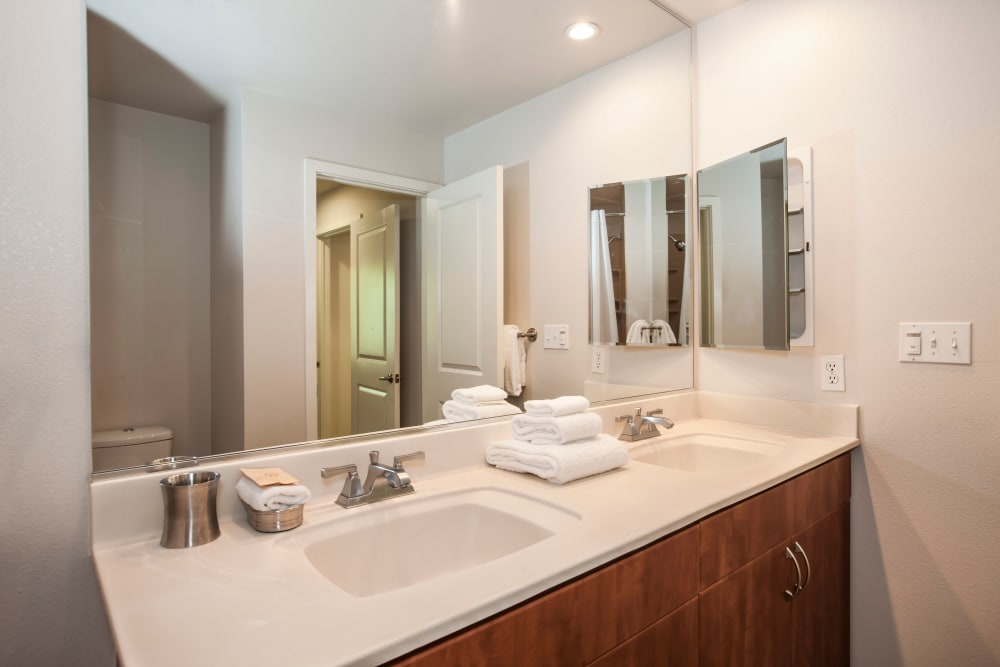 Bathroom with white sink at Azure Apartment Homes in Petaluma, California