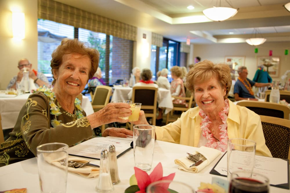 Residents friends enjoying dinner at Merrill Gardens at Bankers Hill in San Diego, California.