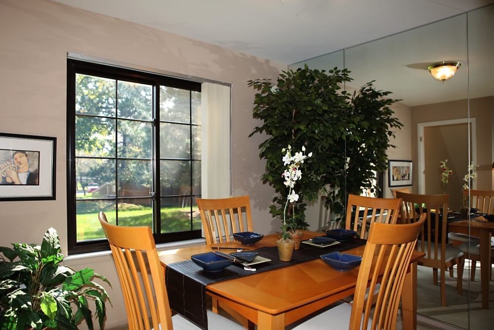 Dining area in model home at Saddle Creek Apartments in Novi, Michigan