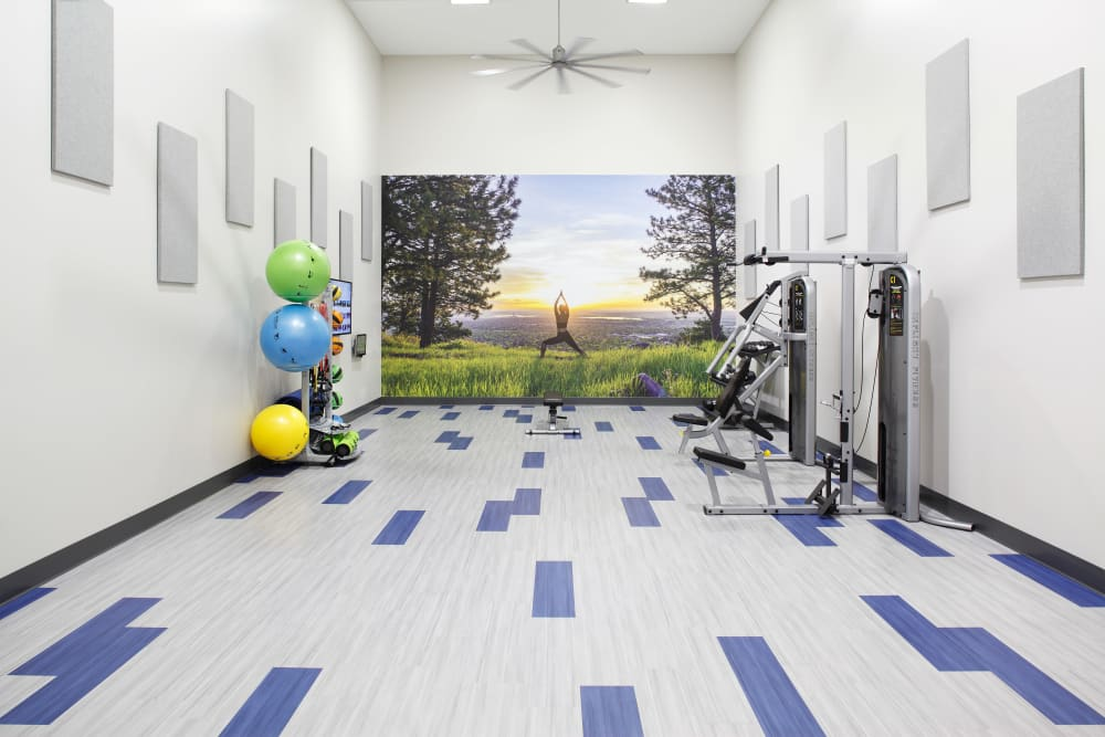 Fitness center with plenty of individual workout stations at Park South Apartments in Seattle, Washington