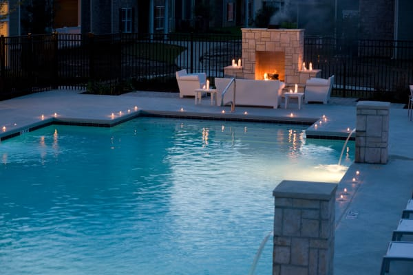 Resident pool with outdoor fireplace at Plantation Crossing in Lafayette, Louisiana.