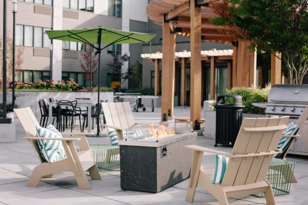 Comfortable seating and fire pit at outdoor common area at Grant Park Village