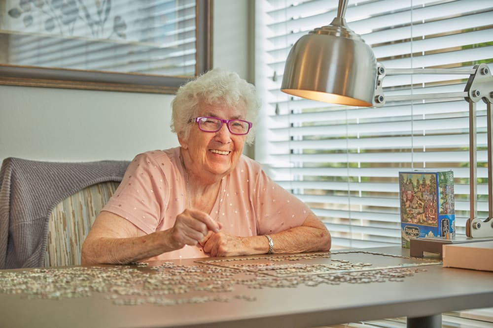 Resident doing a puzzle in Florence, Oregon