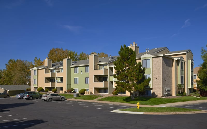 Green and tan exterior of Alton Green Apartments in Denver, Colorado
