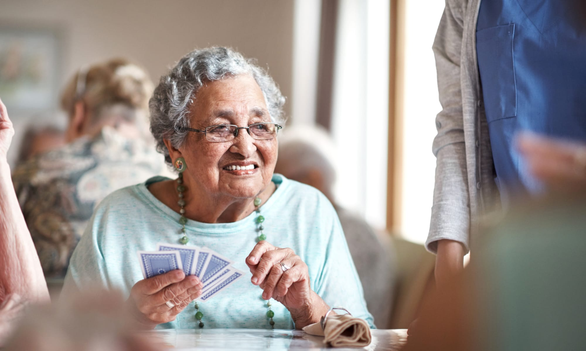 Resident playing cards at a Retirement Center Management community