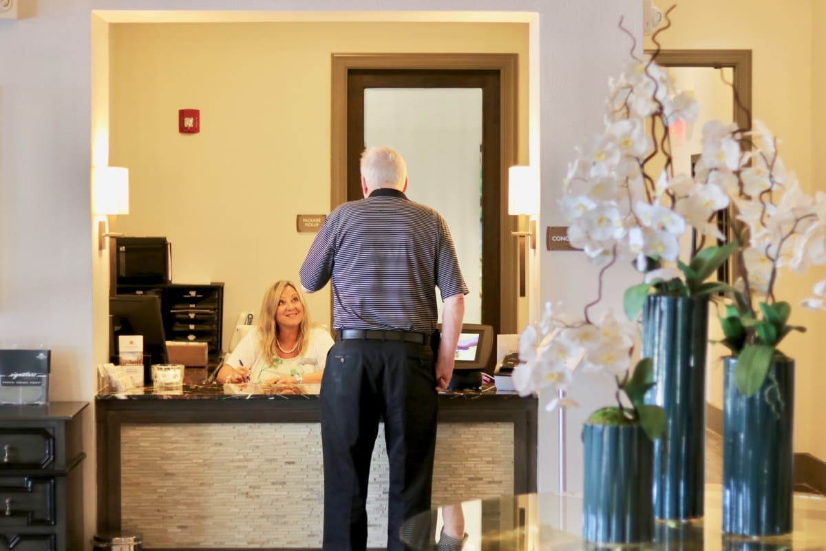 Resident at the front desk of Watercrest at Bryan in Bryan, Texas