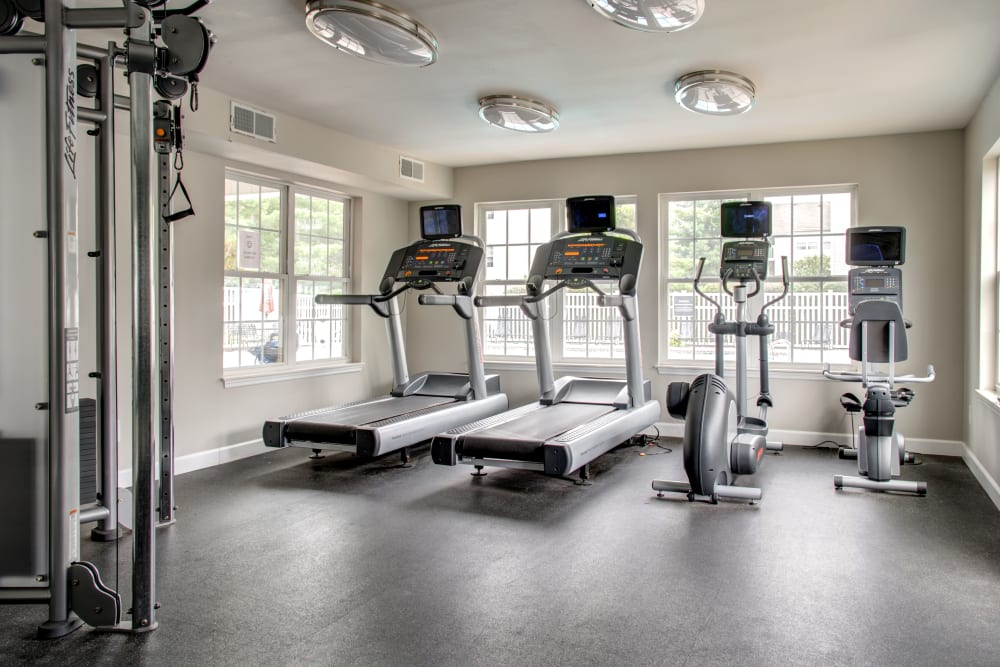 A modern community gym with treadmills at Greenway Chase in Florissant, Missouri