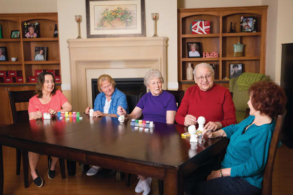 Residents enjoying an activity at The Enclave at Round Rock Senior Living in Round Rock, Texas