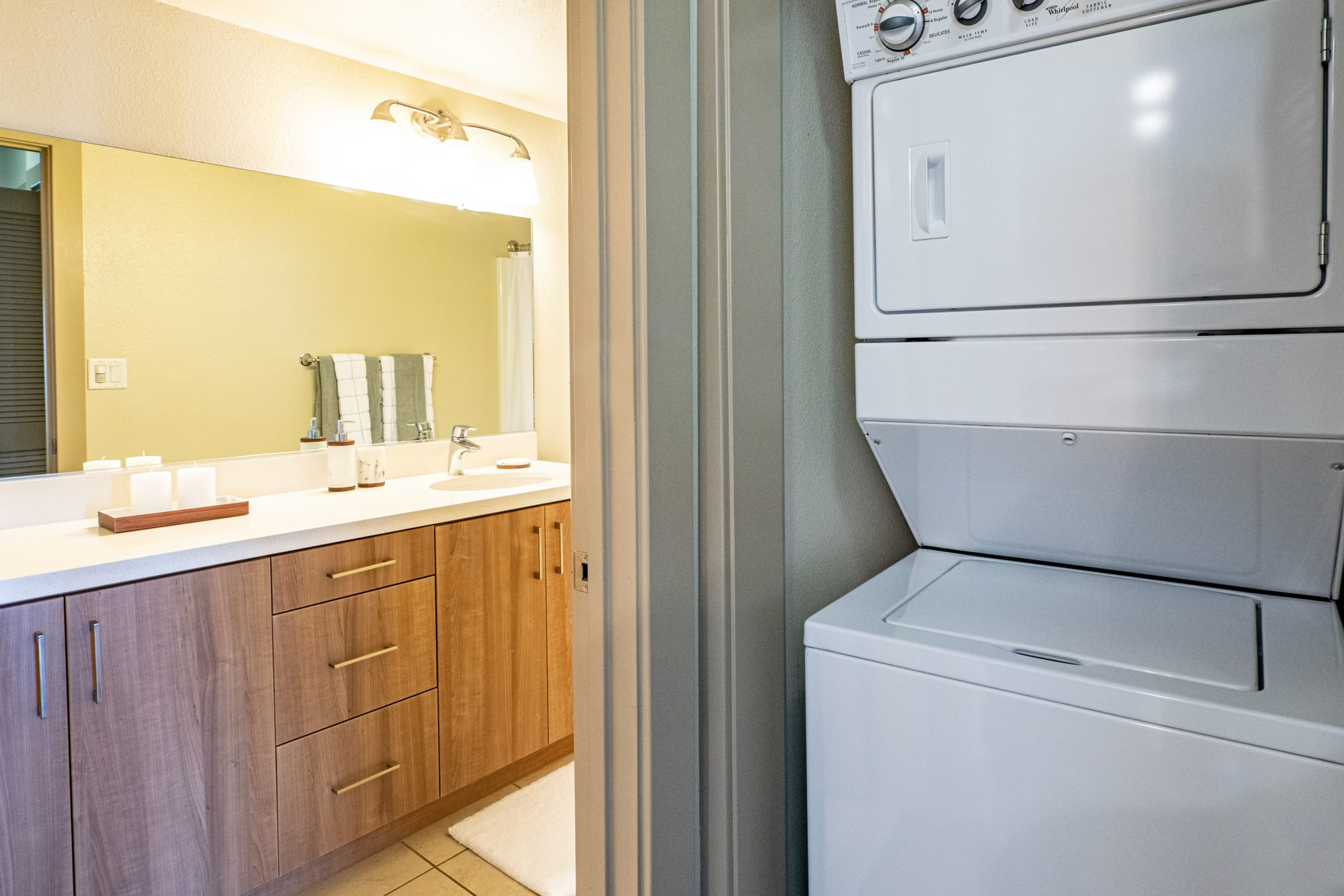 A washer and dryer outside a modern bathroom at Harborside Marina Bay Apartments in Marina del Rey, California