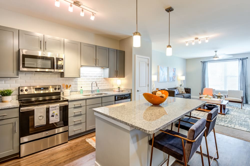 Roomy kitchen with plenty of lighting at Flats At 540 in Apex, North Carolina