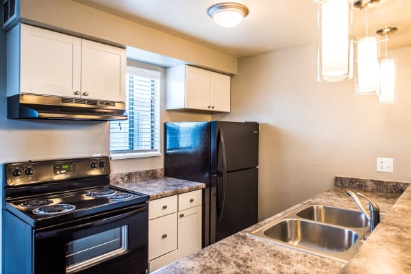 Modern kitchen at Parkwood Plaza Apartments in Denver, Colorado