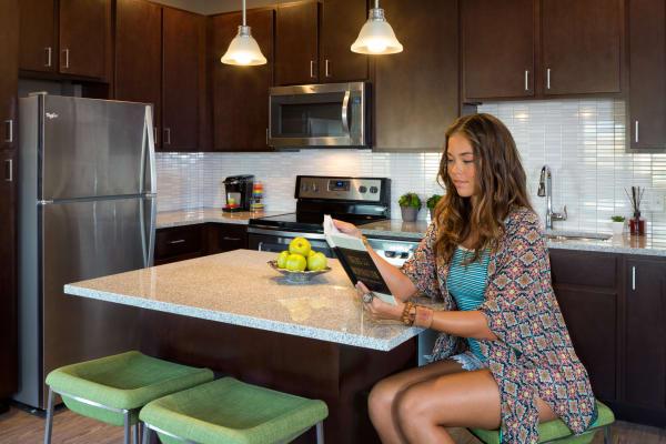 Resident in spacious kitchen at Kapolei Lofts in Kapolei, Hawaii