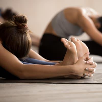 Resident doing yoga at a local studio in Clayton, Missouri near Two Twelve Clayton