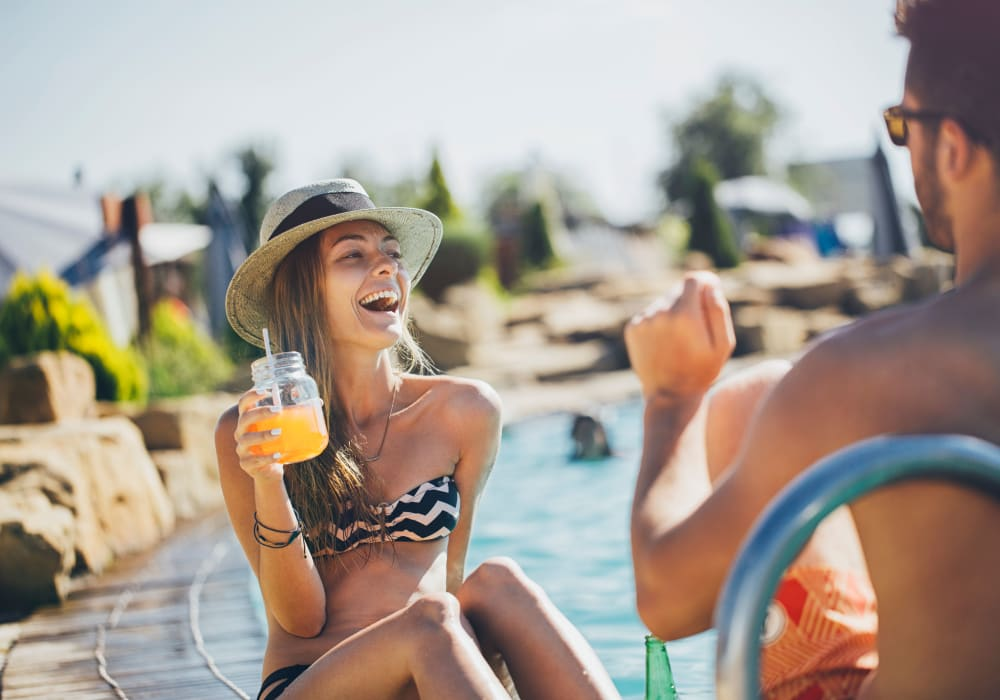 Residents enjoying some drinks at the pool at Sofi Belmont Hills in Belmont, California