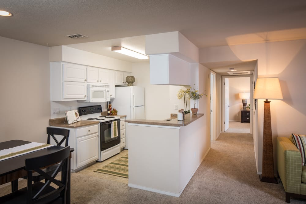 Kitchen, dining room and hallway at Reserve at Capital Center Apartment Homes in Rancho Cordova, California