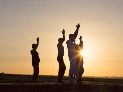 Residents doing yoga outdoors near Element Oakwood in Dayton, Ohio