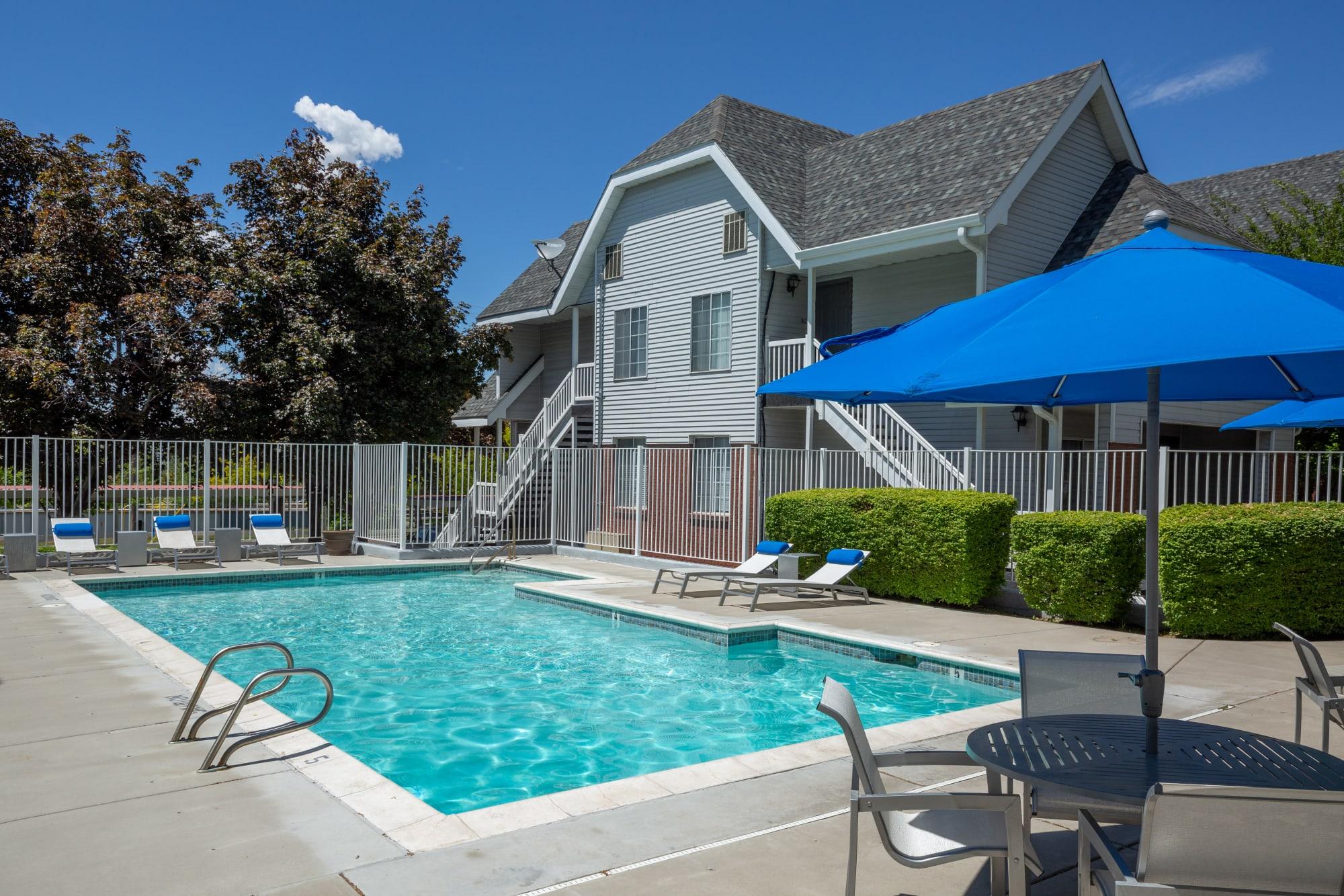 A shimmering swimming pool at Windgate Apartments in Bountiful, Utah