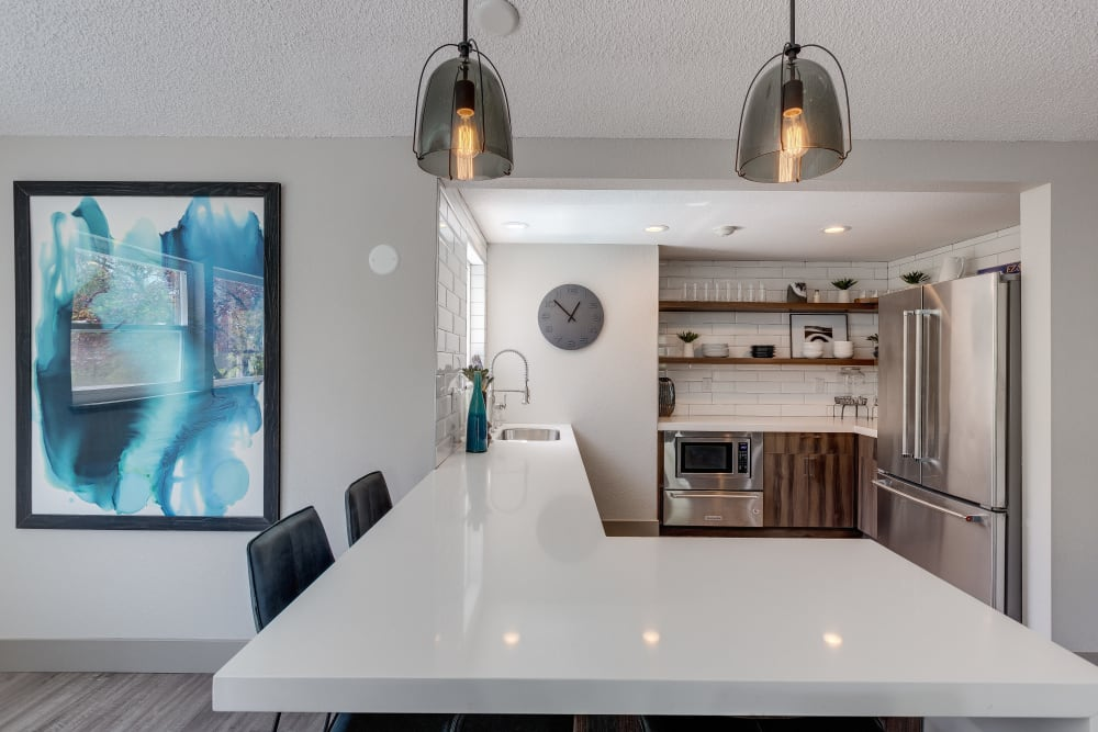 Lovely kitchen with modern appliances at Alaire Apartments in Renton, Washington