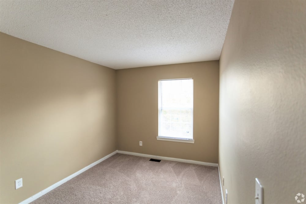 Bedroom with window at Cypress Creek Townhomes
