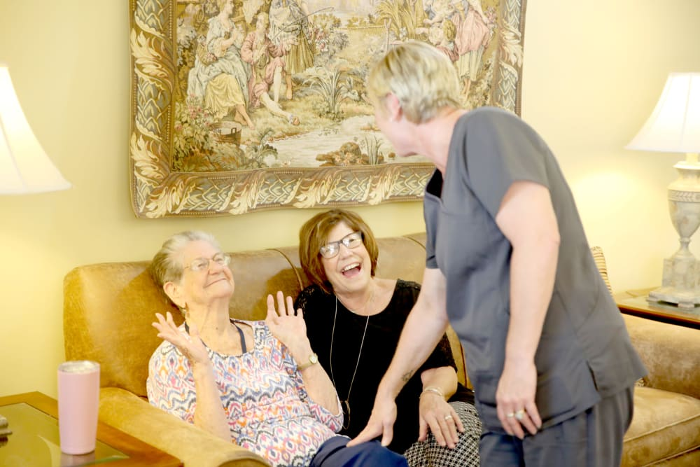 A resident having a good time talking with family and a staff member at Providence Assisted Living in Batesville, Mississippi.