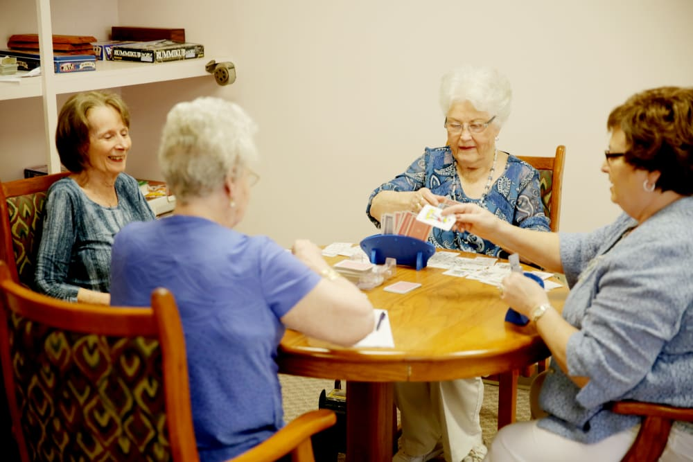 A group of residents playing a card game at Providence Assisted Living in Searcy, Arkansas.