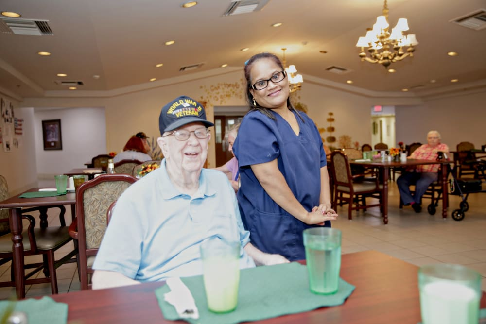 A staff member serving a meal to a resident at Providence Assisted Living in Springdale, Arkansas.