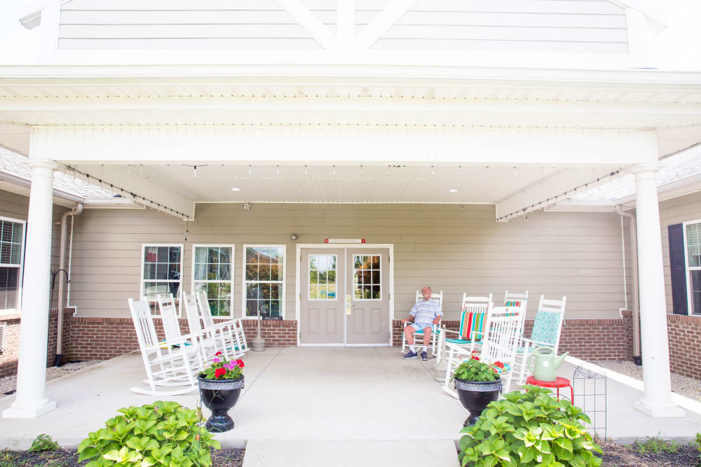 Rocking chairs on resident porch at Arcadian Cove in Richmond, Kentucky.