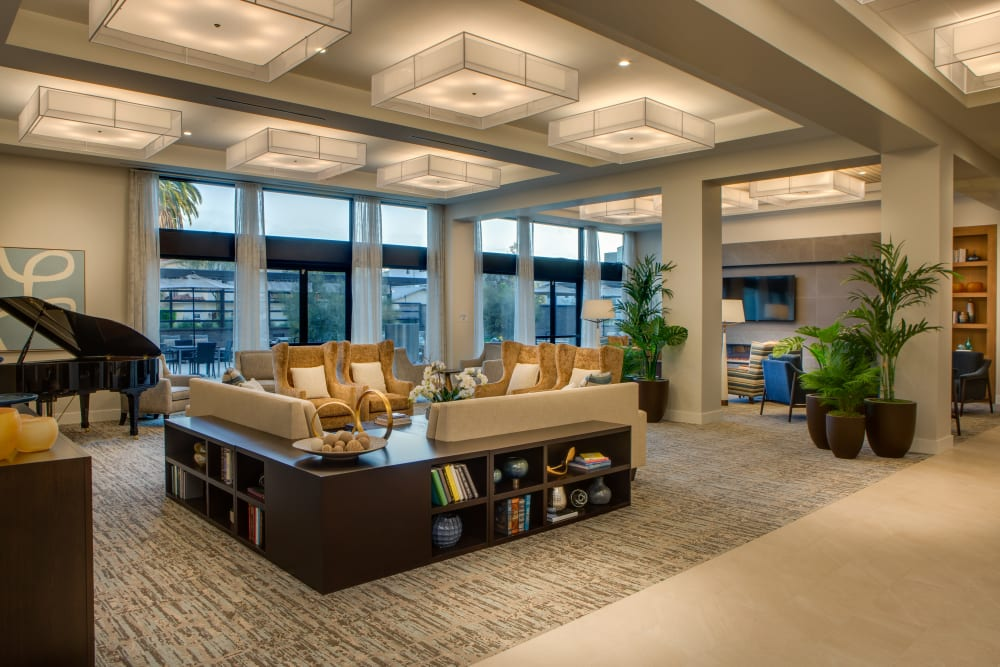 Comfortable lounge area with piano at Sage Glendale in Glendale, California