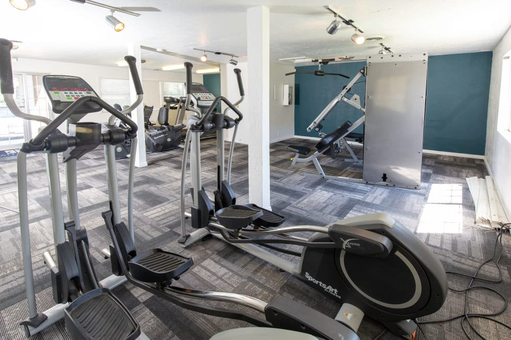 Fitness center with plenty of individual workout stations at Callaway Apartments in Taylorsville, Utah