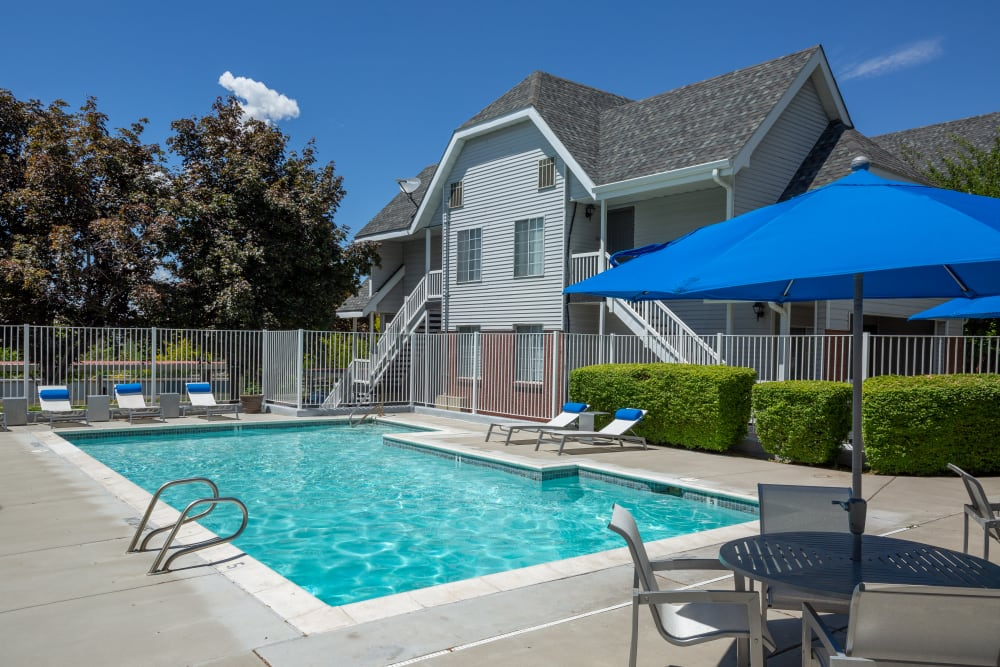 Beautiful resort-style swimming pool at Windgate Apartments in Bountiful, Utah