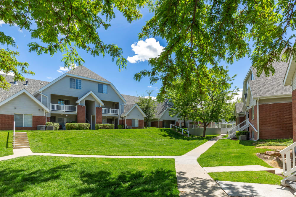 Enjoy the lush landscaping at Windgate Apartments in Bountiful, Utah