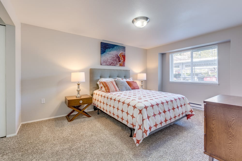 Master bedroom with a large window for natural lighting at Cascade Ridge in Silverdale, Washington