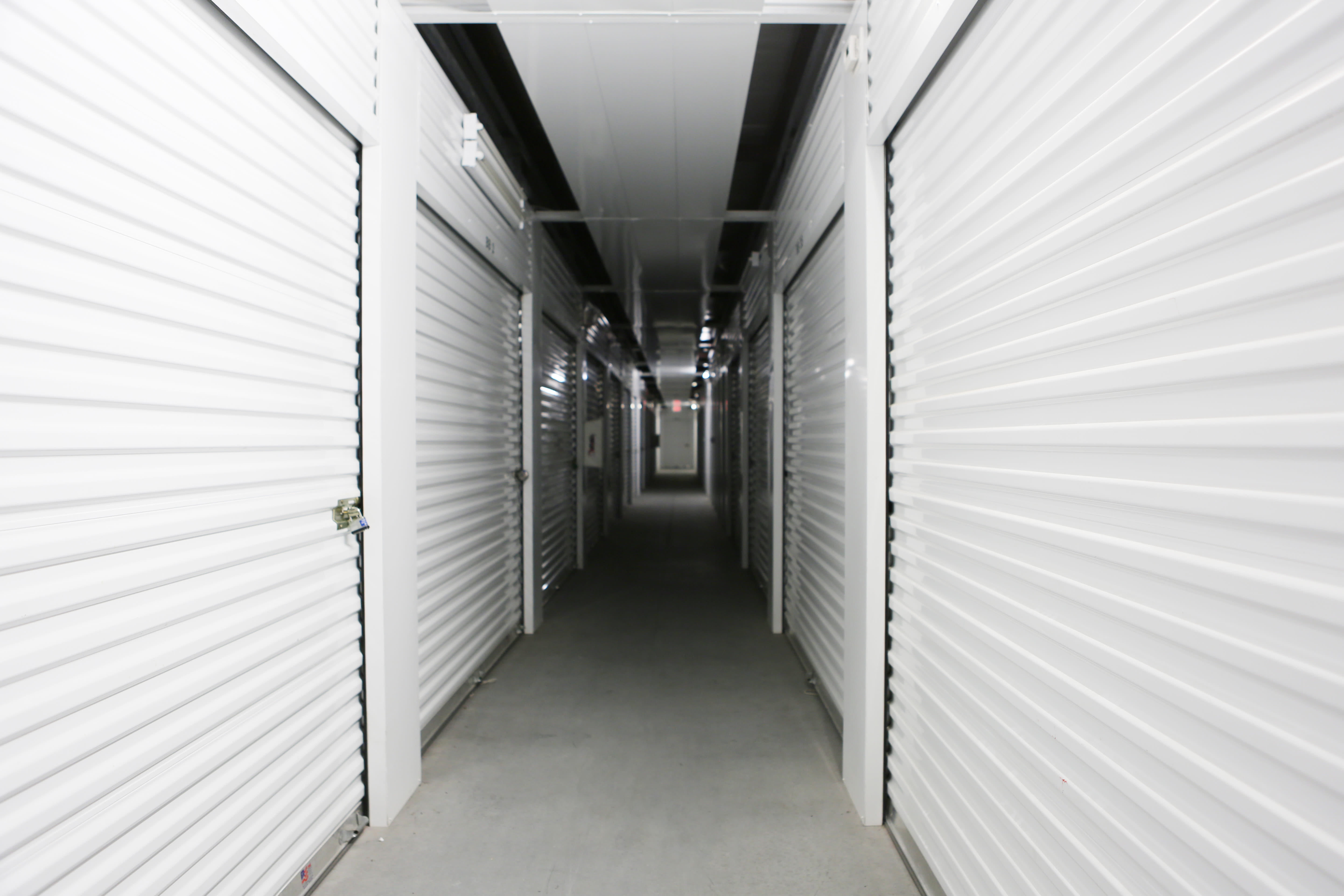 Storage units with white doors at Midgard Self Storage in Melbourne, Florida
