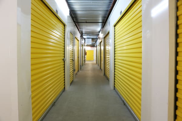 Interior units with yellow doors at StoreSmart Self-Storage in Charleston, South Carolina