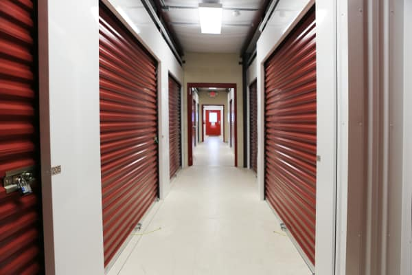 Interior units with red doors at StoreSmart Self-Storage in Englewood, Florida