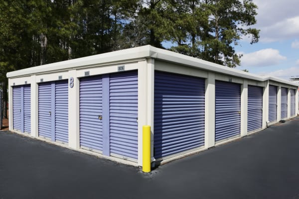 Storage units with blue doors at StoreSmart Self-Storage in Fayetteville, North Carolina