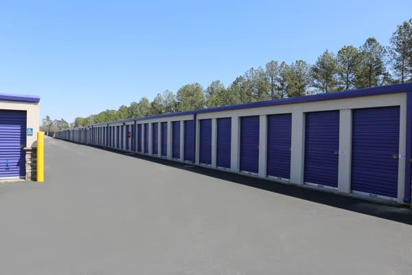 Storage units with blue doors at StoreSmart Self-Storage in Conway, South Carolina
