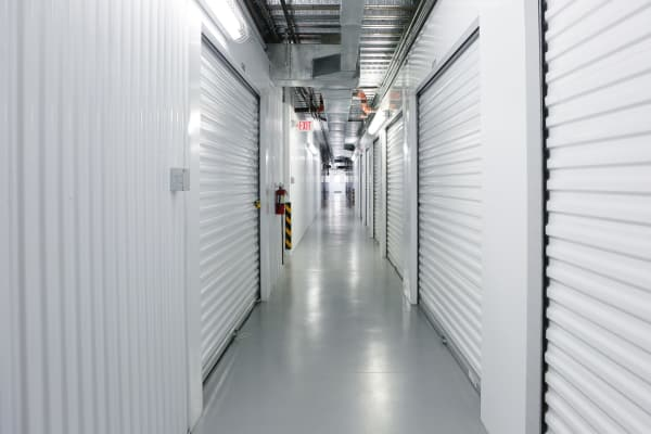 Interior units with white doors at StoreSmart Self-Storage in Raleigh, North Carolina