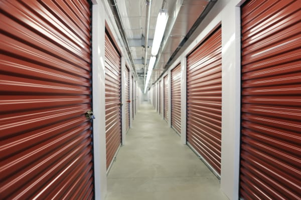 Interior units with red doors at Clover Basin Self-Storage in Longmont, Colorado