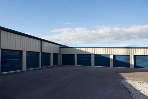 Storage units with blue doors at Midgard Self Storage in Naples, Florida